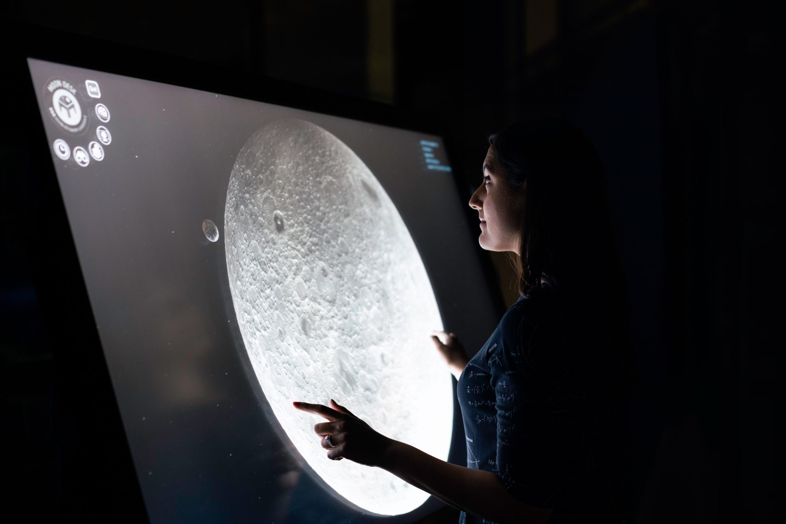 The Futurecast Epidsode 1: Learning Habitats. Girl playing with a image of the Moon